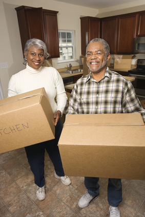 Senior couple with moving boxes