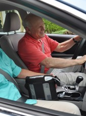 Man with Inogen One G3 Portable Oxygen Concentrator Driving Car