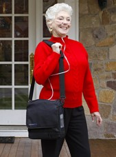 Lady in Red Sweater with an Inogen Portable Oxygen Concentrator