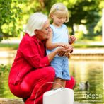 Woman in Red with Inogen One G2 Portable Oxygen Concentrator and Child