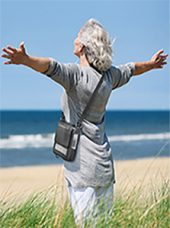 woman on beach with Inogen One G5